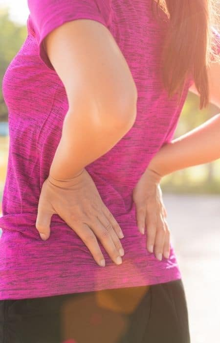 woman holder back from pain